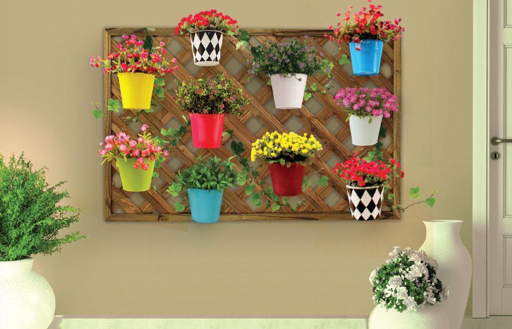 jardim vertical vasos meia lua : jardim vertical vasos meia lua:usando parafusos e depois é só pendurar os vasinhos em meia-lua