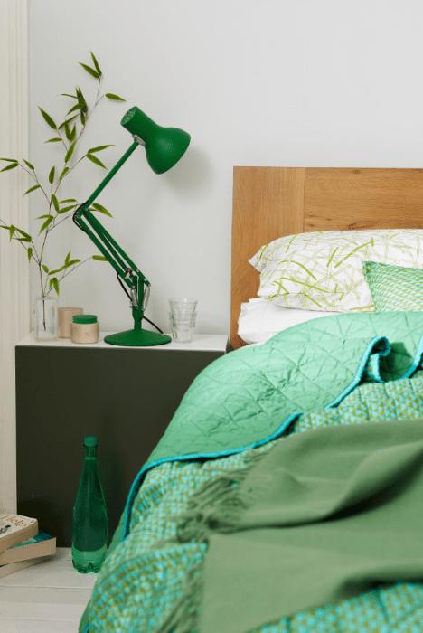 Verde na decoração do quarto.