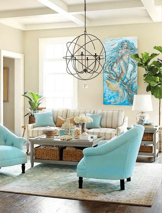 Quadro de sereia e sala com pitadas de azul turquesa.