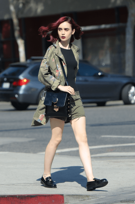Lily Collins looks.